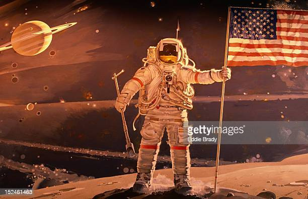 Astronaut holding American flag in space mural by Robert McCall, National Air and Space Museum.