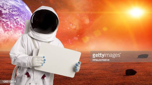 Astronaut In Space Holding A Sign On Alien Planet