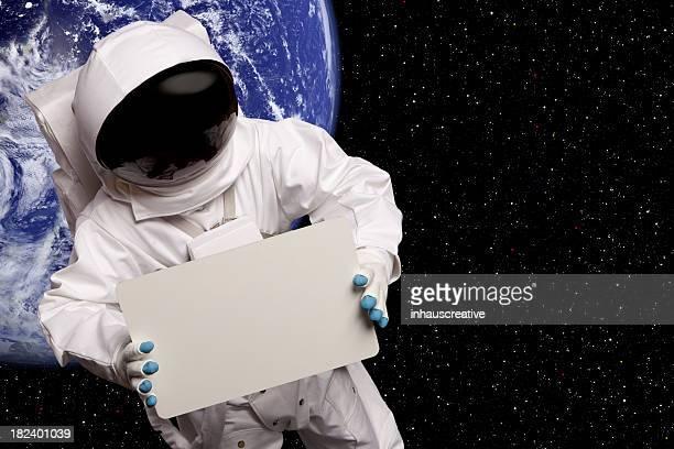 Astronaute dans l'espace planète bleue signe au-dessus de