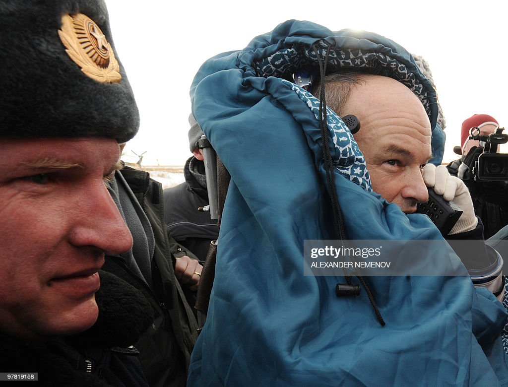 US astronaut Jeffrey Williams speaks on a satellite telephone after landing in the Russian 'Soyuz TMA-16' space capsule not far from the Kazakh town of ... - astronaut-jeffrey-williams-speaks-on-a-satellite-telephone-after-in-picture-id97819158