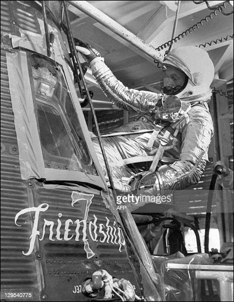 US astronaut John Glenn gets into the Mercury capsule Friendship 7 during a training session for his 20 February 1962 NASA's Mercury program space...