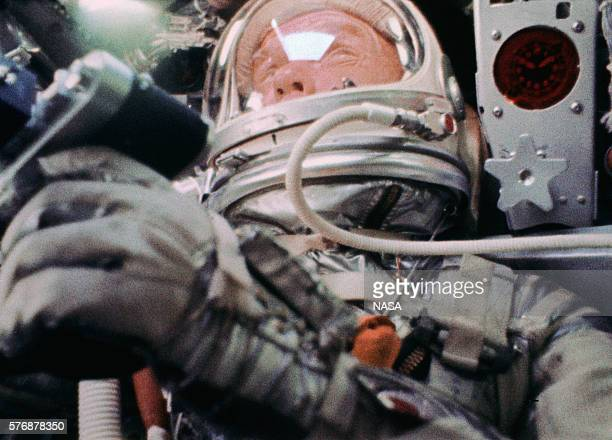 Astronaut John Glenn inside the MercuryAtlas 6 Friendship 7 spacecraft during his historic mission to orbit the earth This image was taken by a movie...