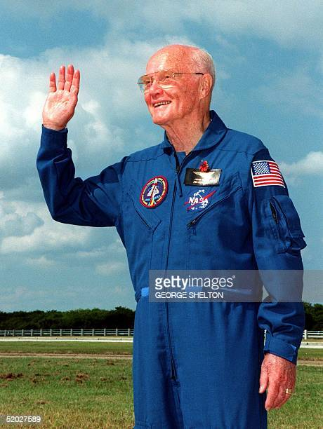 US astronaut John Glenn waves to friends and relatives 28 October for the last time before he blasts off into space aboard the US space shuttle...