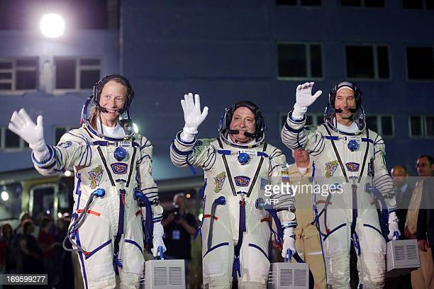 US astronaut Karen Nyberg Russian cosmonaut Fyodor Yurchikhin and European Space Agency Italian astronaut Luca Parmitano walk from their hotel to a...