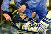 US astronaut Kate Rubins from NASA looks on as her space suit is tested at the Russianleased Baikonur cosmodrome early on July 7 2016 NASA astronaut...