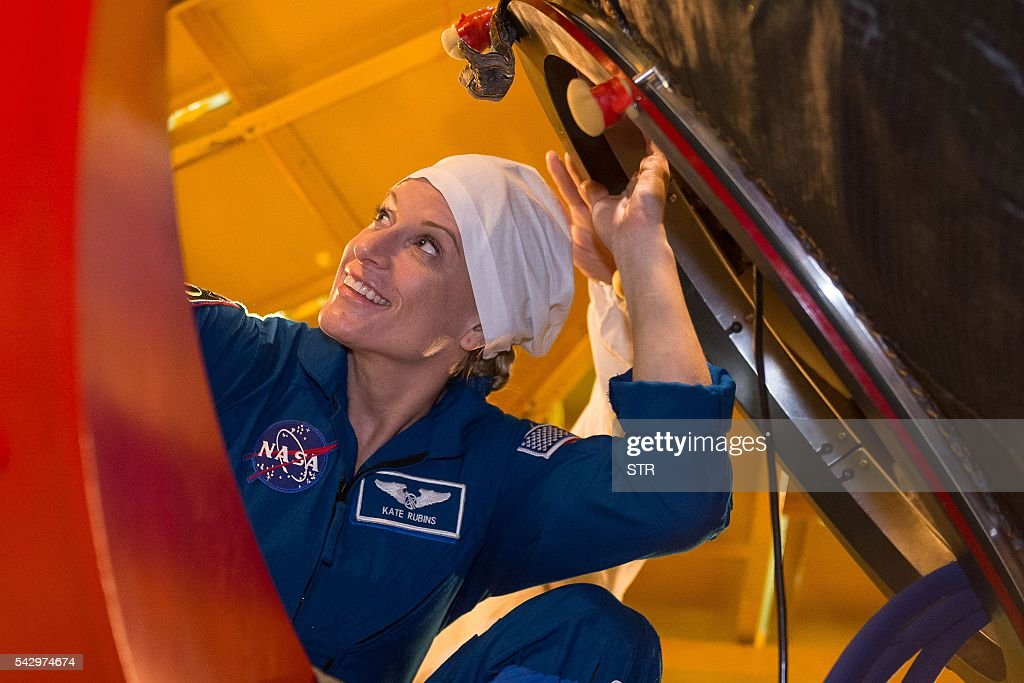 US NASA astronaut Kate Rubins, member of the main crew of the 48/49 expedition to the International Space Station (ISS), gets into the Soyuz MS01 space vehicle in an assembling department at the Russian-leased Baikonur cosmodrome in Kazakhstan on June 25, 2016. The trio is to take off from Kazakhstan's Baikonur cosmodrome to the International Space Station (ISS) on July 7, 2016. / AFP / STR