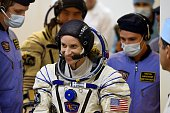 US astronaut Kate Rubins smiles on as her space suit is tested at the Russianleased Baikonur cosmodrome early on July 7 2016 local time NASA...