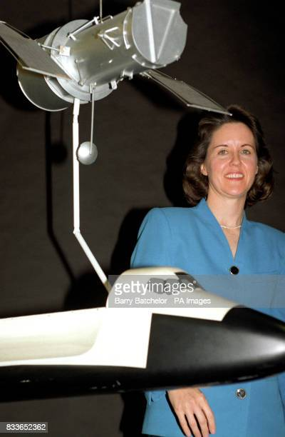 Astronaut Kathryn Thornton with a model of the 'Shuttle' and the Hubble Space Telescope during a visit to British Aerospace at Filton Bristol