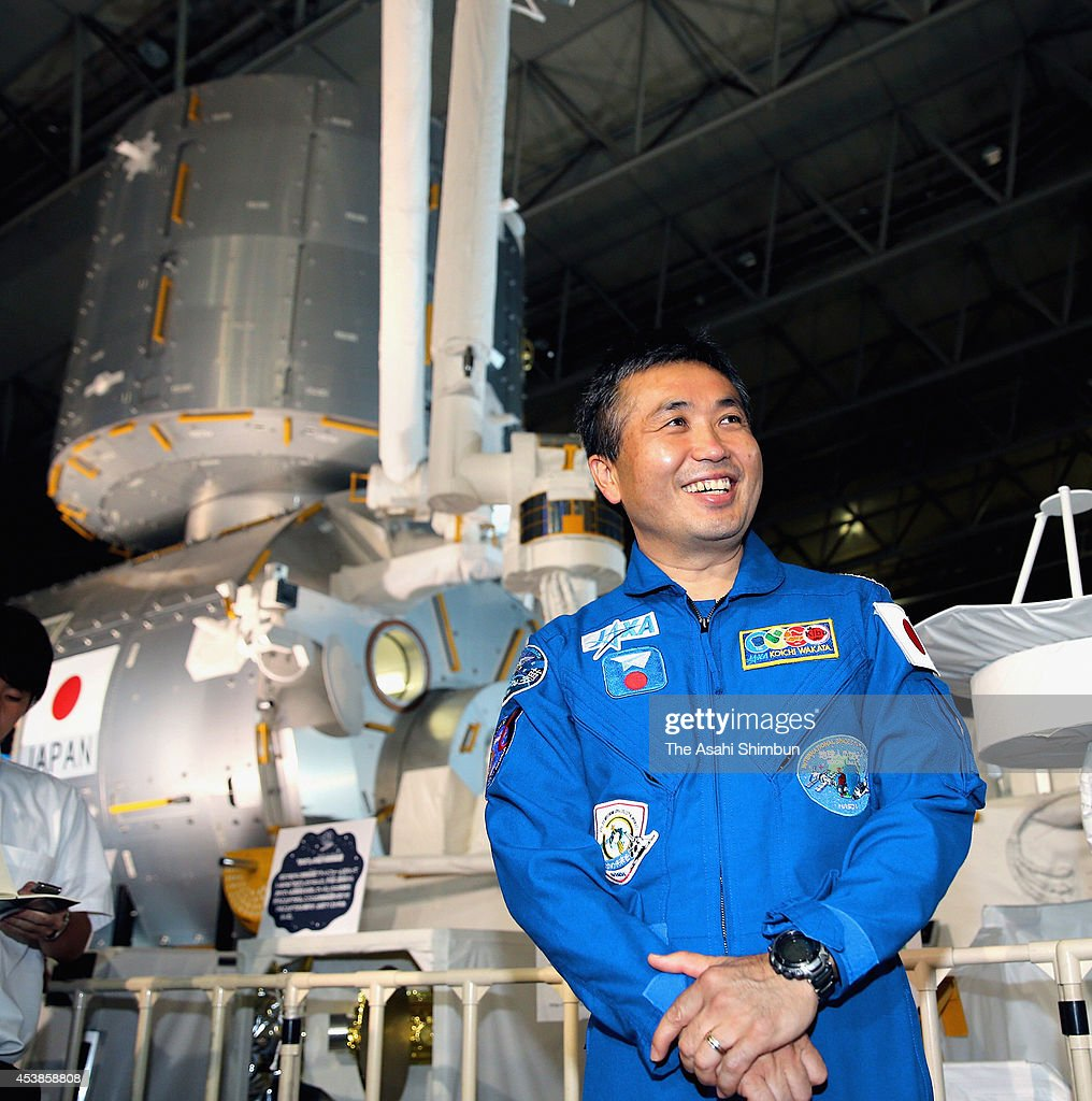 Astronaut <a gi-track='captionPersonalityLinkClicked' href=/galleries/search?phrase=Koichi+Wakata&family=editorial&specificpeople=220363 ng-click='$event.stopPropagation()'>Koichi Wakata</a> poses for photographs in front of the replica of the Kibo, Japanese Experiment Module during the Space Expo at Makuhari Messe on August 19, 2014 in Chiba, Japan.