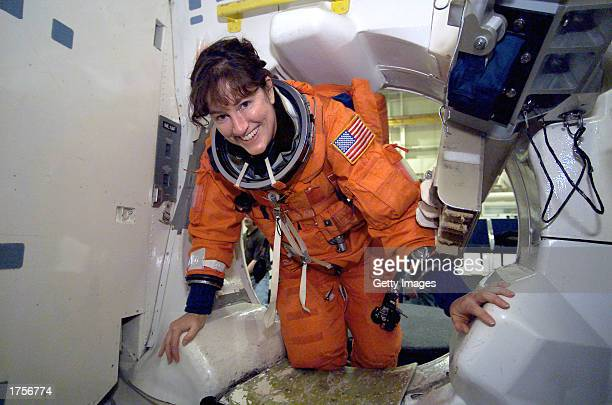Astronaut Laurel B Clark participates in a mission training session in one of the high fidelity trainer/mockups in the Space Vehicle Mockup Facility...