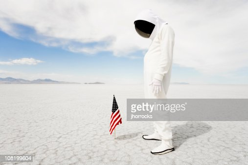 Astronaut Looking At American Flag Stock Photo | Getty Images
