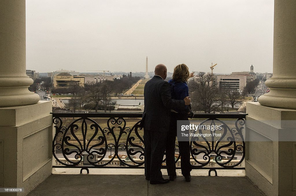 Astronaut Mark Kelly and his wife former Congresswoman Gabrielle Giffords look out at the view from the Speaker's balcony while making the rounds to talk about the issue of gun violence on Capitol Hill in Washington, D.C., on Wednesday, February 13, 2013.