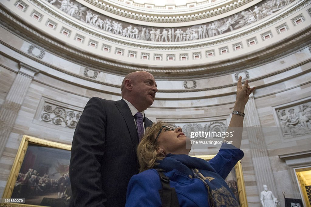 Astronaut Mark Kelly pauses in the Capitol Rotunda as Former Congresswoman Gabrielle Giffords gazes up at the mural on Capitol Hill in Washington, D.C., on Wednesday, February 13, 2013. The couple made the rounds on the Hill to talk to leaders in Congress about the issue of gun violence.