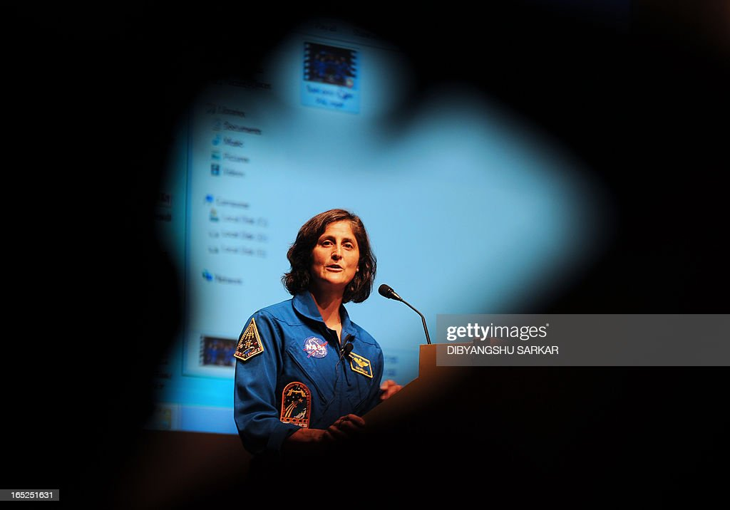 US astronaut of Indian-Slovenian origin Sunita Williams gestures during an interaction with Indian school students at the Science City in Kolkata on April 2, 2013. Williams holds a world record for total cumulative spacewalk time by a female astronaut and has spent a total of 322 days in space on two missions. AFP PHOTO/Dibyangshu SARKAR