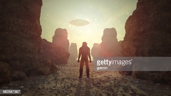 Astronaut on distant planet discovering UFO