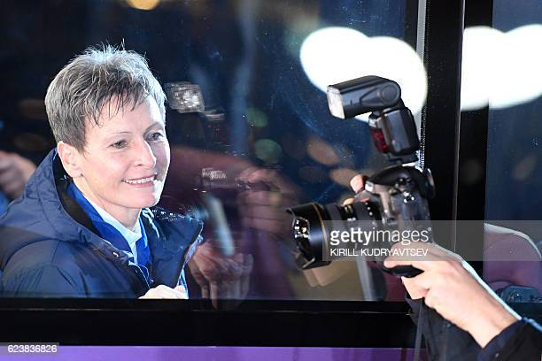 US astronaut Peggy Whitson looks out from inside a bus as she leaves to board the Soyuz MS03 spacecraft at the Russianleased Baikonur cosmodrome on...