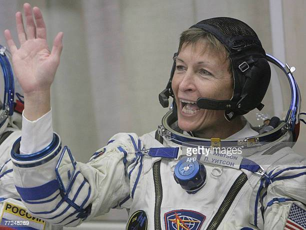 US astronaut Peggy Whitson waves during a farewell ceremony at the Baikonur cosmodrome in Kazakhstan 10 October 2007 Malaysia's first astronaut was...