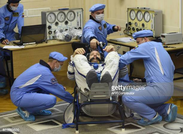 NASA astronaut Randy Bresnik a member of the main crew of the 52/53 expedition to the International Space Station reacts as his spacesuit is tested...