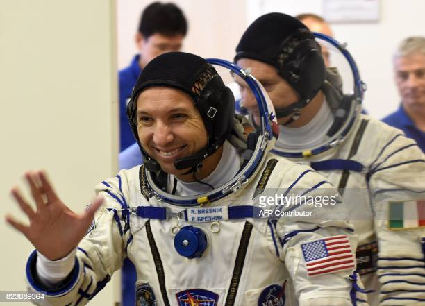 NASA astronaut Randy Bresnik walks with colleague ESA astronaut Paolo Nespoli members of the main crew of the 52/53 expedition to the International...