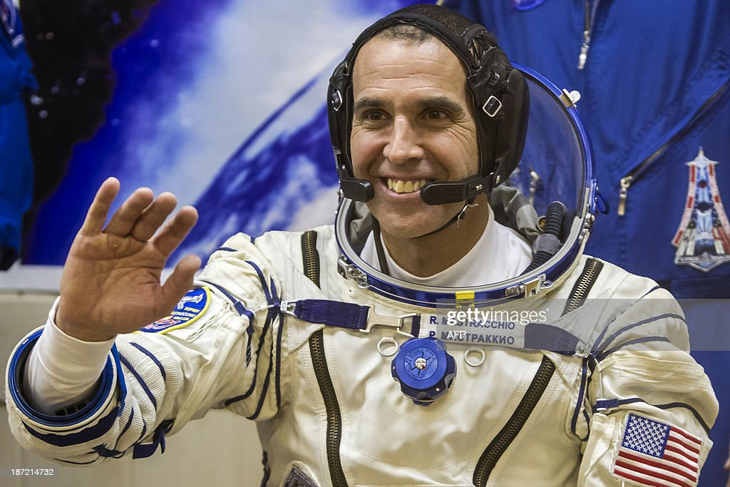 US astronaut Rick Mastracchio smiles during space suit test prior to blast off to the International Space Station (ISS) from the Russian-leased Baikonur cosmodrome in Kazakhstan early on November 7, 2013. Russia on November 7 launched into space a trio of Russian, Japanese and US astronauts carrying an unlit Olympic torch that will for the first time be taken on a spacewalk to mark the 2014 Winter Games in Sochi. The Soyuz-FG rocket and Soyuz-TMA capsule, emblazoned with the symbols of the Sochi Games and the Olympic rings, blasted off for the International Space Station (ISS) from Baikonur.