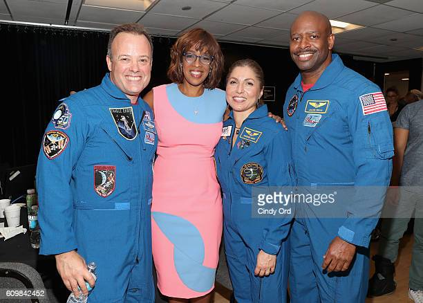 NASA astronaut Ron Garan Gayle King businesswoman and selffunded space traveler Anousheh Ansari and NASA astronaut Leland Melvin pose backstage...