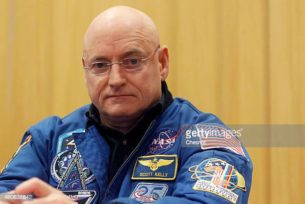 US astronaut Scott Kelly attends to a press conference with Russian cosmonaut Mikhail Kornienko at the UNESCO on December 18 2014 in Paris France...