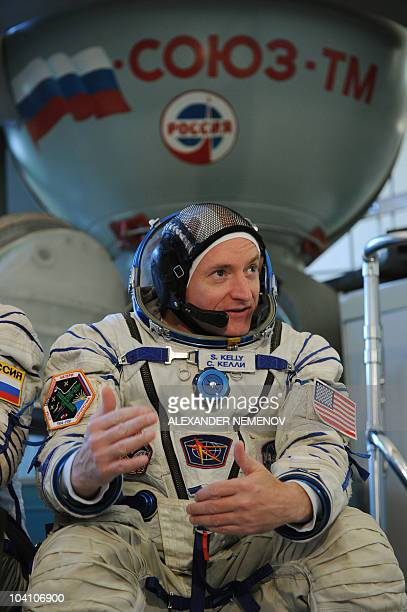 US astronaut Scott Kelly poses for a picture near a Soyuz flight simulator during an examination session at the Star City space centre outside Moscow...