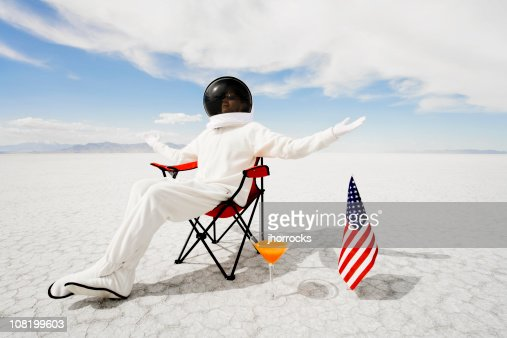 Astronaut Sitting in Lawn Chair
