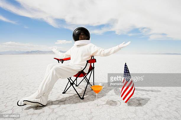 Astronaut Sitting in Lawn Chair