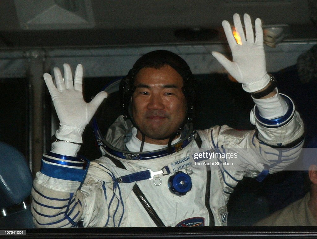 Astronaut <a gi-track='captionPersonalityLinkClicked' href=/galleries/search?phrase=Soichi+Noguchi+-+Astronaut&family=editorial&specificpeople=246534 ng-click='$event.stopPropagation()'>Soichi Noguchi</a> of Japanese Aerospace Exploration Agency (JAXA) waves to reporters before boarding to the Soyuz TMA-17 spacecraft at Baikonur cosmodrome on December 21, 2009 in Baikonur, Kazakhstan.