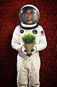 Astronaut Standing Against Quirky Wallpaper