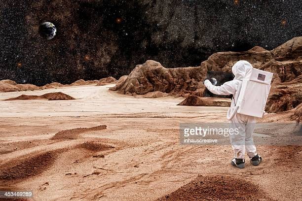 Astronaut Studying Map On Mars or the Moon