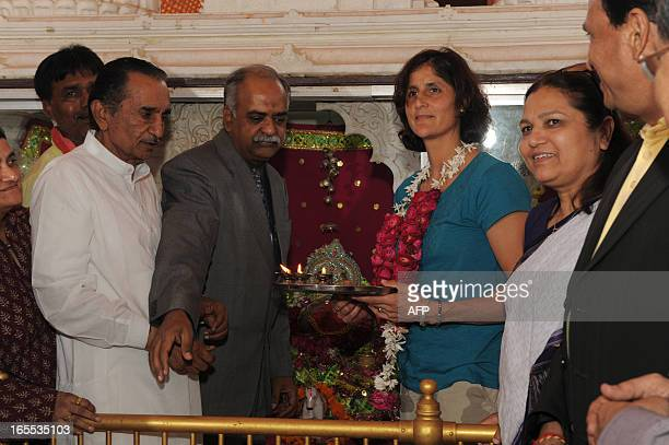 US astronaut Sunita Williams preforms rituals at the Dola Mataji Temple during prayers at Jhulasan Village where she was born some 50 kms from...