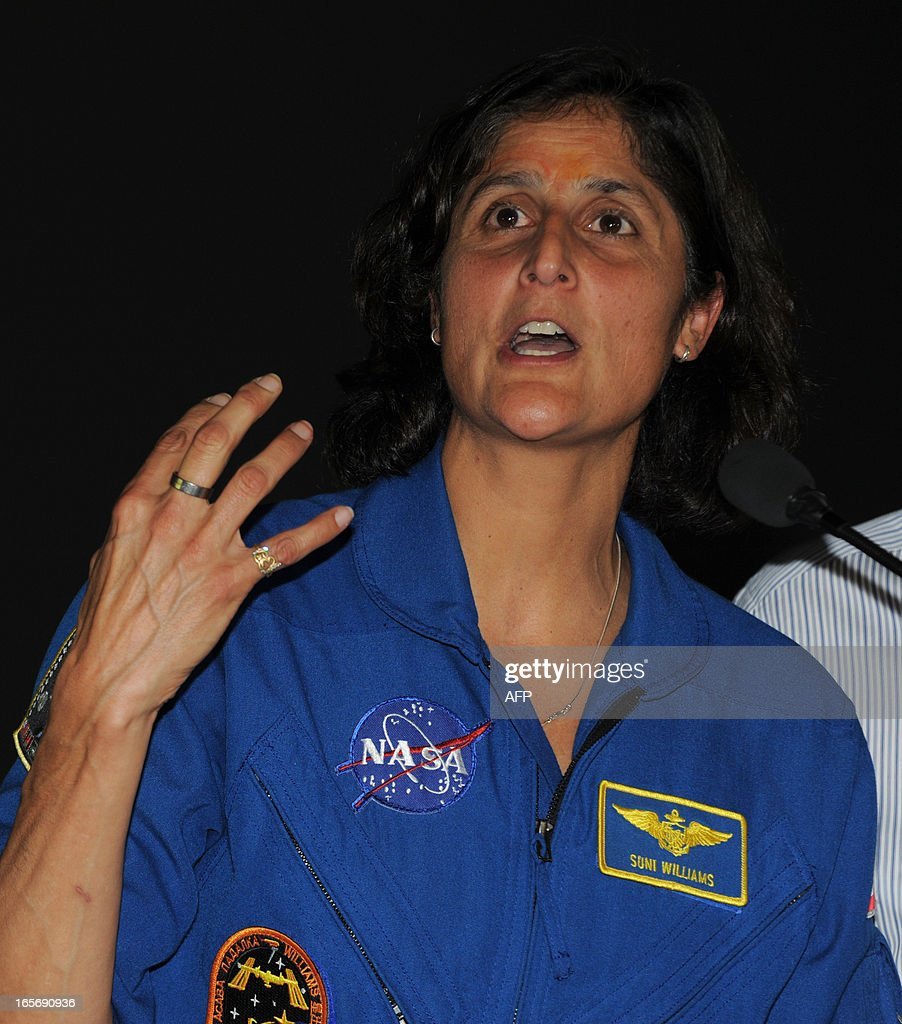 US astronaut Sunita Williams (R) speaks to students during her visit at the Gujarat Science City on the outskirts of Ahmedabad on April 5, 2013. Williams holds a world record for total cumulative spacewalk time by a female astronaut and has spent a total of 322 days in space on two missions. AFP PHOTO / Sam PANTHAKY