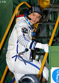 Astronaut Takuya Onishi of the Japan Aerospace Exploration Agency member of the main crew of the mission to the International Space Station walks to...