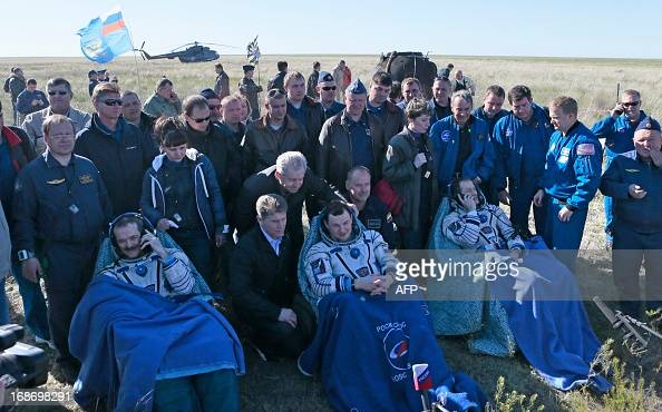 US astronaut Thomas Marshburn Russian cosmonaut Roman Romanenko and Canadian astronaut Chris Hadfield rest and make phone calls shortly after the...