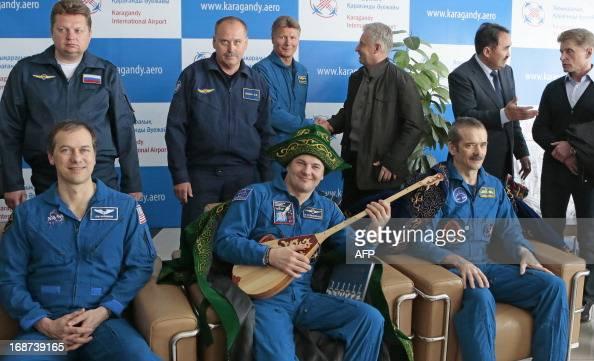 US astronaut Thomas Marshburn Russian cosmonaut Roman Romanenko and Canadian astronaut Chris Hadfiel pose for a photo after the landing aboard the...