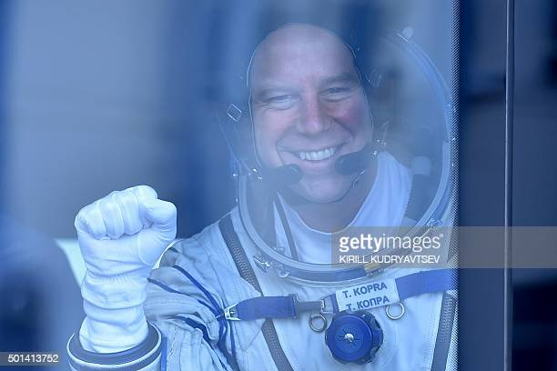 US astronaut Tim Kopra gestures from a bus after his space suit was tested at the Russianleased Baikonur cosmodrome on December 15 2015 Russia's...