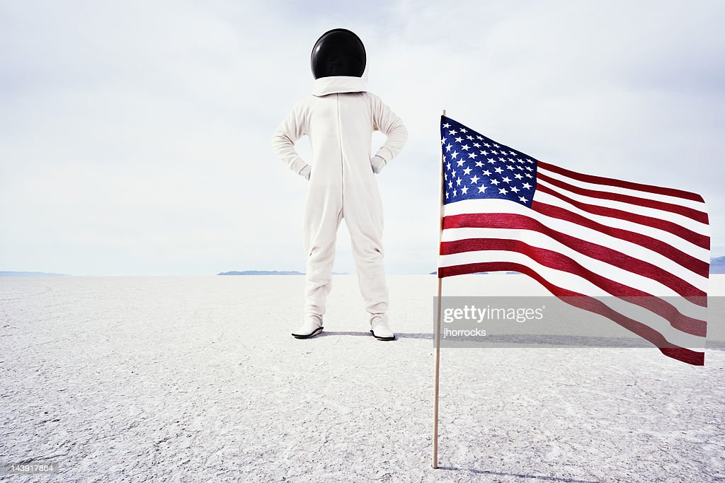 Astronaut With American Flag Stock Photo | Getty Images