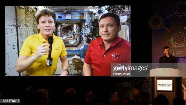 NASA astronauts Cmdr Peggy A Whitson and Col Jack Fischer are shown live on screen from the International Space Station using a RED Epic Dragon...