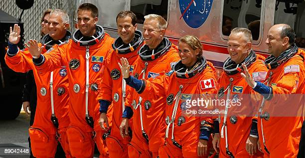 STS127 astronauts Dave Wolf Christopher CassidyTom Marshburn Tim Copra Canadian Julie Payette Pilot Doug Hurley and Commander Mark Polansky pose for...