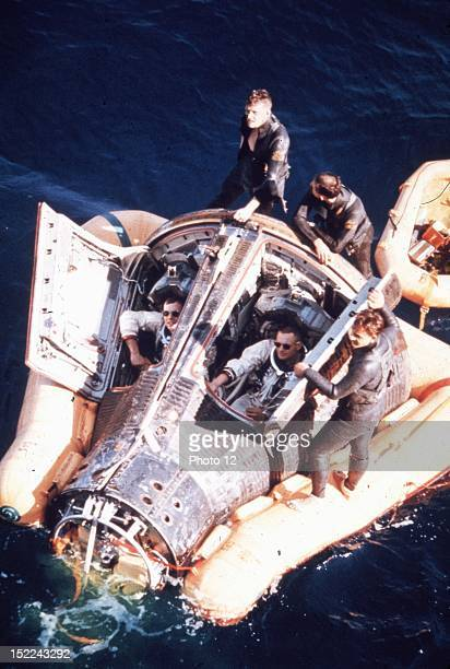 US astronauts David Scott and Neil Armstrong sits inside their Gemini 8 spacecraft afloat in the Pacific Ocean