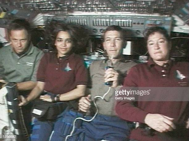 Astronauts on board the Space Shuttle Columbia speak during an interview from space during mission STS107 between 16th January and 1st February 2003...