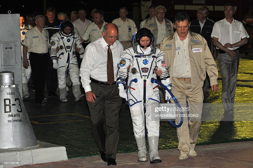 US astronauts Shannon Walker (C) boards a Russian Soyuz TMA-19 rocket at Kazakhstan's Russian-leased Baikonur cosmodrome on June 15, 2010.