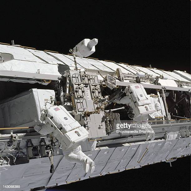 Astronauts Working On International Space Station Astronauts Michael E LopezAlegria And John B Herrington Sts113 Mission Specialists Work Near The...