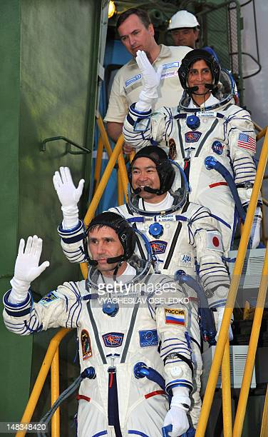 Astronauts Yuri Malenchenko of Russia Sunita Williams of the US and Akihiko Hoshide of Japan wave before boarding the Soyuz TMA05M spacecraft at the...