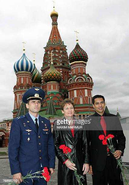 Astronauts Yury Malenchenko of Russia Peggy Whitson of the USA and Sheikh Muszaphar Shukor Malaysia's soontobe first astronaut lay flowers at the...