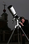 Astronomer Brendan Owens poses for a photograph with a 6 inch refractor telescope at the Royal Observatory in Greenwich on March 19 2015 in London...