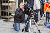 Astronomer observing through celestron telescope