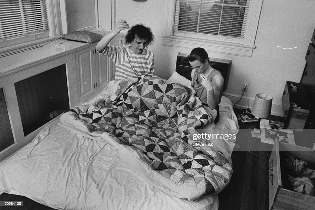 Astronomer/computer mgr. Cliff Stoll sitting in bed w. his wife Martha Matthews, helping her sew a patchwork quilt at home; prob. Baltimore.